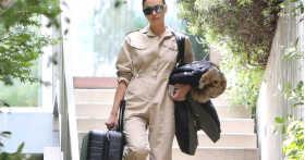 Ирина Шейк навсегда ушла из дома Купера с чемоданом в руках и комбинезоне